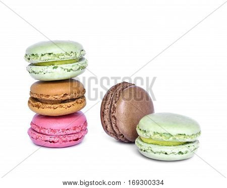 Delicious multicolored macaroons, isolated on white background. Studio isolated macaroon candy, stack rock.