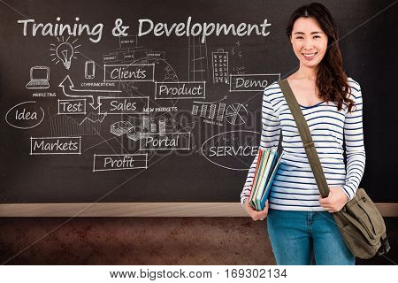 Cheerful woman with shoulder bag and files against blackboard on wall