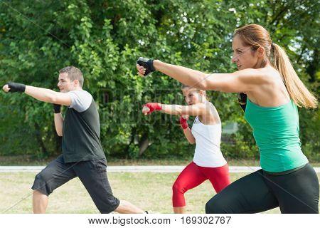 Three People On Tae Bo Training