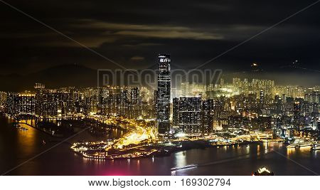 Business concept for real estate and corporate construction - panoramic modern city skyline bird eye aerial view with night sky in Hong Kong (HK) China