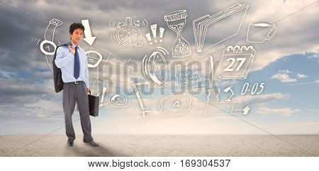 Portrait of a businessman holding a briefcase and his jacket on his shoulder against ominous landscape
