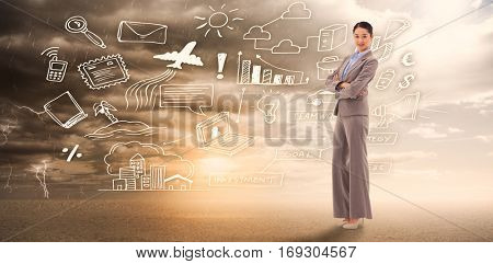 Portrait of a gorgeous businesswoman with the arms crossed against ominous landscape