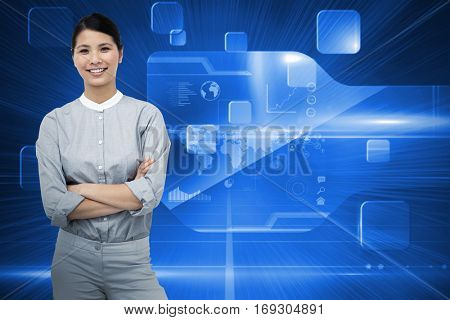 Selfassured businesswoman with folded arms against futuristic technology interface