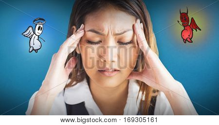 Nervous businesswoman holding her head against blue background