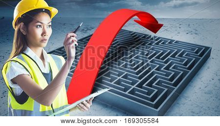 Architect woman with yellow helmet and plans against big maze with arrow under cloudy sky