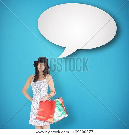 Pretty woman with shopping bags against blue background with vignette