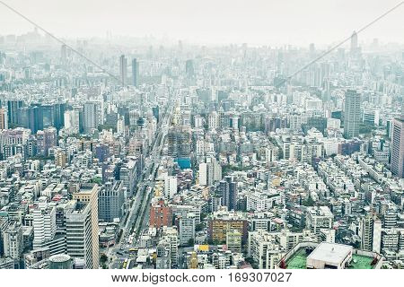 Business concept for real estate and corporate construction : panoramic modern city bird eye view with and morning cloudy grey sky from 101 building in Taipei Taiwan
