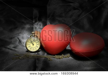 Vintage Clock And Red Heart On Black Background ,love And Time Concept In Still Life Photography.