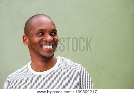 Confident Young Black Man Looking Sideways And Smiling