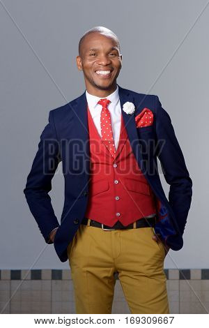 Cool Young African Man In Fashionable Suit Smiling Outdoors