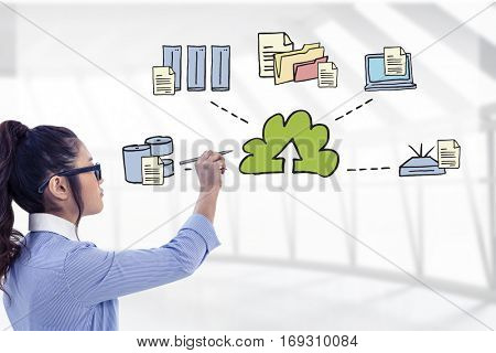 Businesswoman holding disposable cup and looking at wall with notes against spacious room