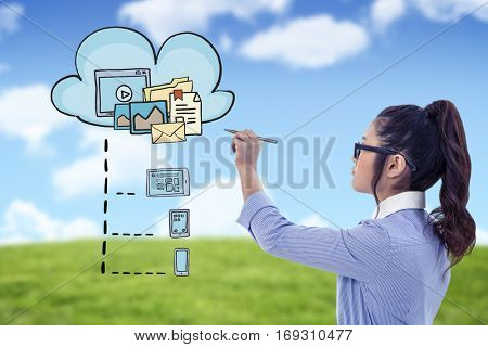 Businesswoman holding disposable cup and looking at wall with notes against blue sky over green field