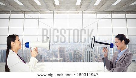 Portrait of a businesswoman shouting through a megaphone against modern room overlooking city
