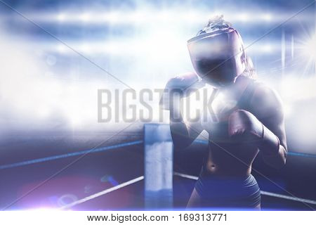 Portrait of female fighter with fighting stance against black background