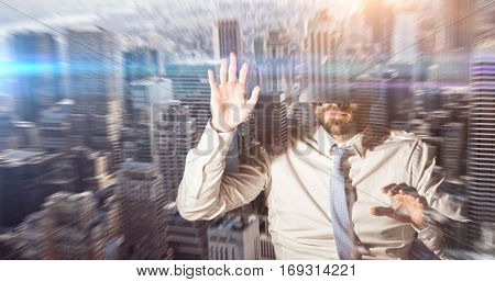 businessman with virtual reality glasses at desk against view of cityscape