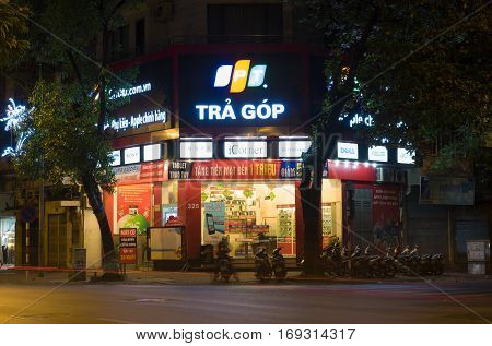 Hanoi, Vietnam - Nov 2, 2014: Front view of a mobile phone store of FPT Telecom in Hanoi capital at night. FPT is one of the biggest technology groups in Vietnam.