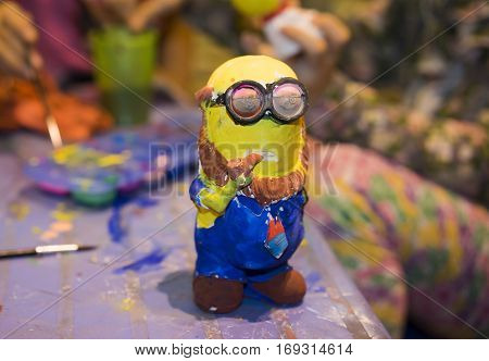Hanoi, Vietnam - Nov 2, 2014: Minion, famous character from animation movie Despicable Me, made from plaster, and painted by children with color ink and brush, on Ma May street.