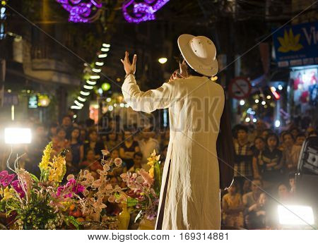 Hanoi, Vietnam - Nov 2, 2014: Male artist performs folk music and song. The show is free for tourist every night on Ma May st in old quarter of Hanoi.