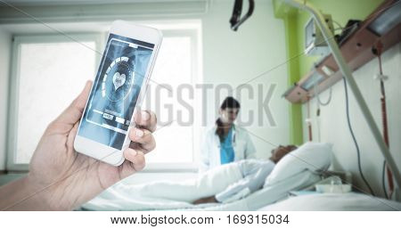Cropped image of businesswoman holding smart phone against doctor taking care of patient