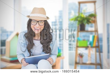 Brunette with tablet pc against view of a business desk