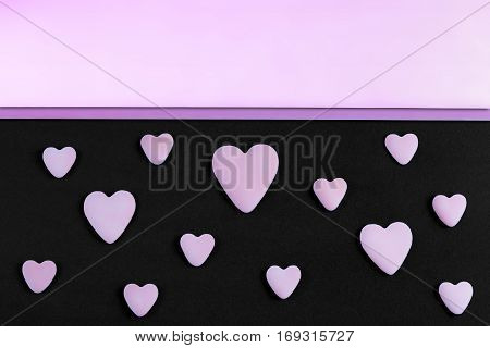 a pattern of serenity hearts on a black background with rose quartz and serenity copy-space