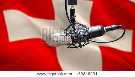 Condenser microphone against digitally generated swiss national flag