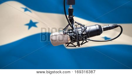 Condenser microphone against digitally generated honduran national flag