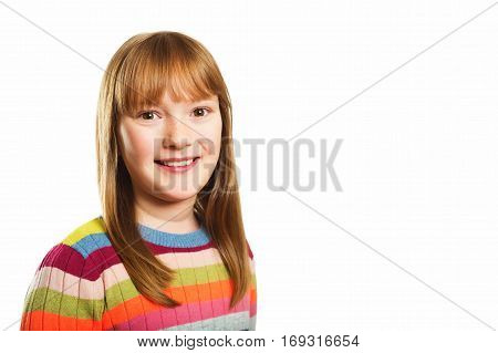 Studio shot of young little 9-10 year old girl, wearing colorful pullover, white background