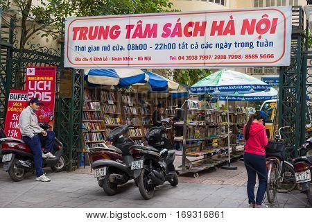 Hanoi, Vietnam - Nov 16, 2014: Exterior view of book store named Hanoi book Center in Dinh Liet street. Selling on sidewalk is common in Hanoi, Vietnam