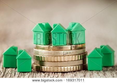 Real estate mortgage concept with green houses and coins