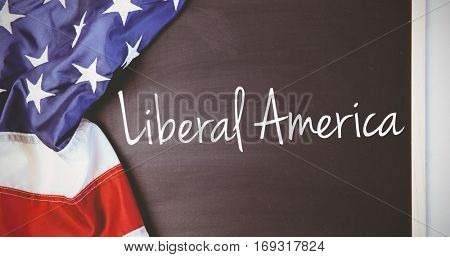 liberal america against american flag on chalkboard