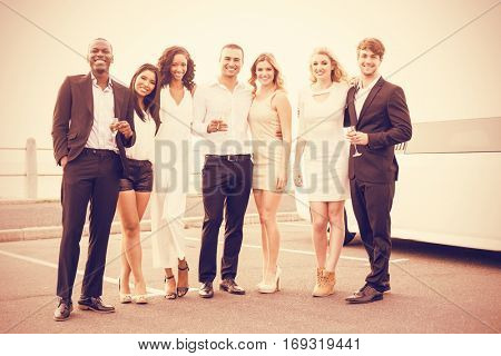 Portrait of cheerful well dressed people posing on night out