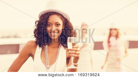 Portrait of friends holding champagne glasses while standing at outdoors