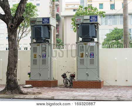 Hanoi, Vietnam - Nov 16, 2014: Electric cabinets on sidewalk of Tran Hung Dao street. Many electric boxes staying on sidewalk are dangerous, especially in raining season