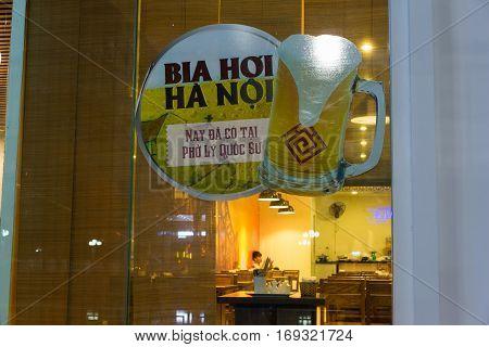 Hanoi, Vietnam - Nov 25, 2014: Sign of Hanoi beer, the popular drink in Hanoi, hang outside of a restaurant at Times City on Minh Khai street