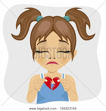 crying little cute girl holding two pieces of broken heart