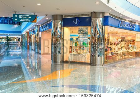 Abu Dhabi, UAE - April 21, 2013: luxury interior shopping center Marina Mall, one of the largest malls in Abu Dhabi and features an observatory, ice rink, movie complex and bowling alley.