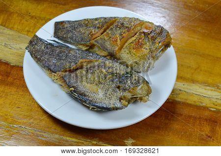deep fried snake skin fish on white dish