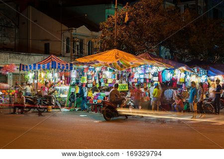 Can Tho, Vietnam - Nov 29, 2014: Can Tho city night market. Tourist visit the market to buy souvenir before leaving the city