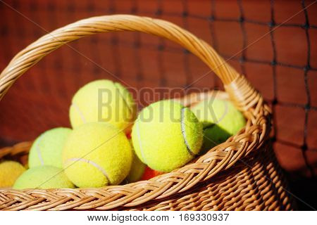 Photography of a tennis balls in a wicker basket