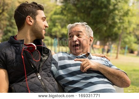 Dad and son having fun in the park