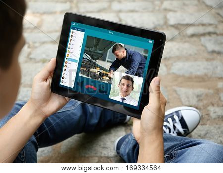 Man video conferencing on tablet. Online car service concept.