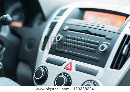 transport, technology and vehicle concept - close up of car dashboard or onboard computer