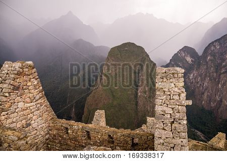 Dark rain clouds at the famous lost Inca city of Machu Picchu, Peru