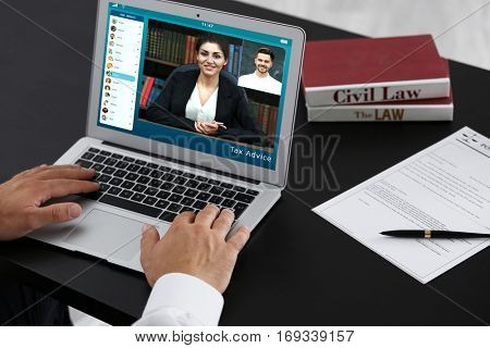 Video conference with financial advisor on laptop. Investment and tax concept.