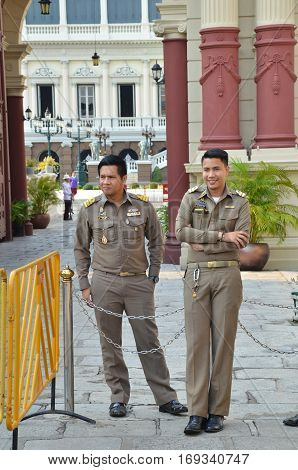 BANGKOK THAILAND- 15 JANUARY 2017: Two security officers on duty in front of Royal Palace in Bangkok Thailand
