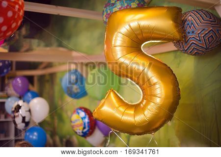 Holiday birthday balloon 5 years. Celebration in honor of the fifth anniversary, a birthday room decorations balls