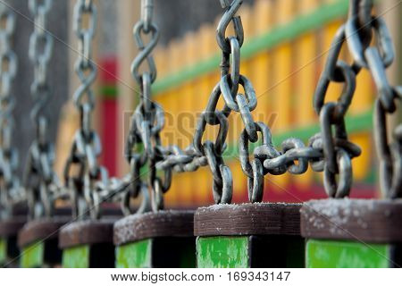 iron chain on the playground in the winter clear day