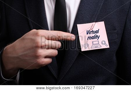 Business, Technology, Internet And Network Concept. Young Businessman Shows The Word: Virtual Realit