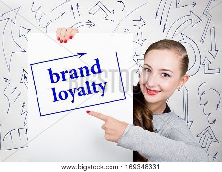 Young woman holding whiteboard with writing word: brand loyalty. Technology, internet, business and marketing